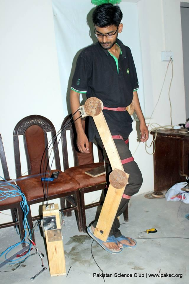 file photo: Hassan working on his project exoskeleton prototype